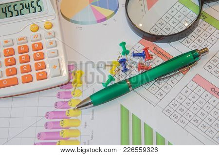 Close Up Business Concept, Calculator, Magnifier, Pen On Financial Report On Table Office. Business