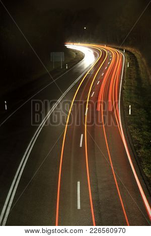 Tracer On A Road In The Night