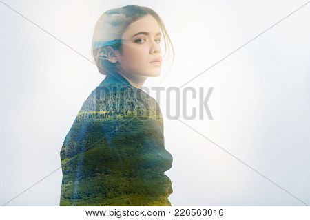 Turn Back. Calm Young Tired Woman Wearing An Elegant Jacket And Looking Gloomy While Turning Her Hea