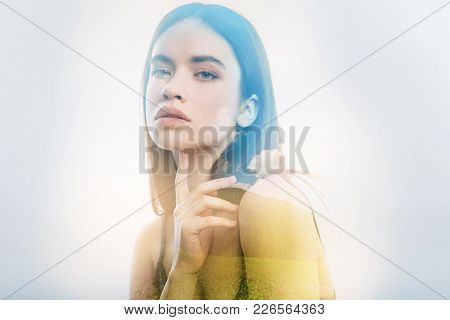 Interest. Calm Smart Serious Woman Looking Thoughtful While Sitting Alone And Touching Her Chin