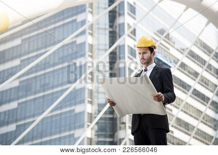 Business Engineer Hand Holding Construction Drawing. Concept Consulting Planning For Engineering.