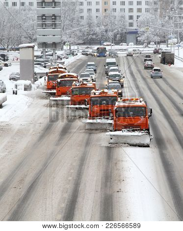 Snow-removing Machines On The City Roads After Snowfall