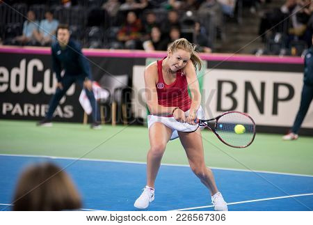Woman Tennis Player Hitting The Ball With Racket