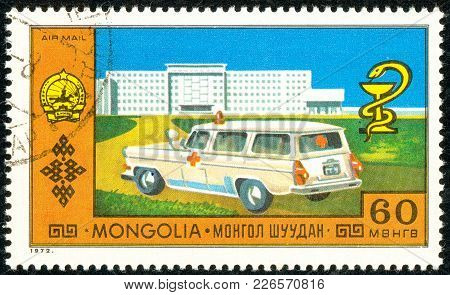 Ukraine - Circa 2018: A Postage Stamp Printed In Mongolia Show Ambulance And Logo Of Medicine. Serie