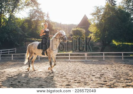 Horse Riding - Blonde Girl Is Riding A Horse
