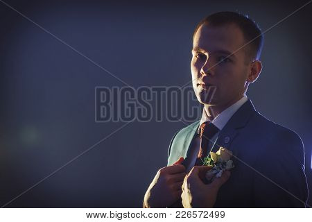 Portrait Handsome Groom In A Blue Suit In The Studio During A Photoshoot With Nice Light