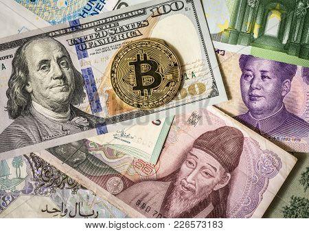 Golden Bitcoin Over Multi Currency Banknotes Dollar, Yuan, Euro