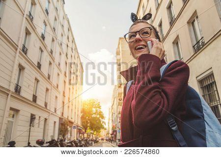 Girl Talking On The Phone In Urban Surroundings.