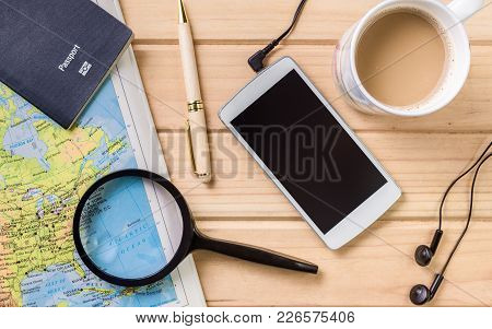 Travel Lay-flat Image With Map, Passport, Pen ,magnifying Glass, Cell Phone And Pen.