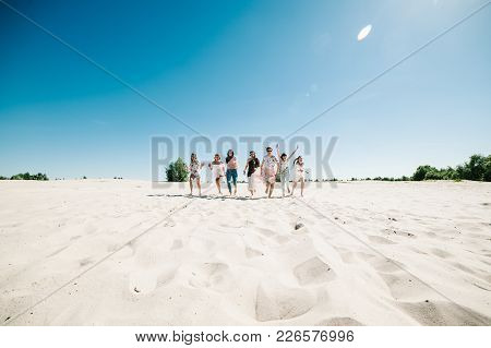 Beautiful Stylish Happy Sexy Slim Young Girls Running On Sand Beach. Party In Style Boho. Bacheloret