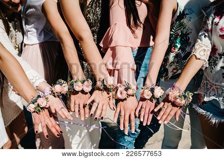 Girls On Beach Show Hands Whis Decorating Boutonniere Of Flowers And Ribbons. Buttonhole. Party Styl