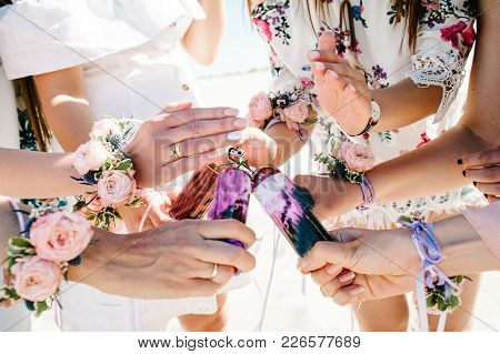 Hands Girls Light Fire Lighter Colored Smoke Bombs. Decorating Boutonniere Of Flowers Ribbons. Butto