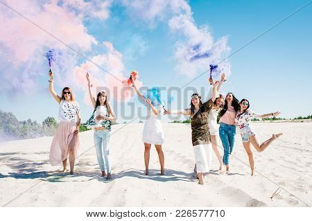 Beautiful Happy Stylish Sexy Young Girls Stand, Go, Run, Jump On Beach And Hold Light Up Colored Smo