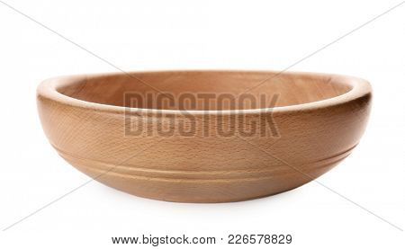 Wooden bowl on white background. Handcrafted cooking utensils