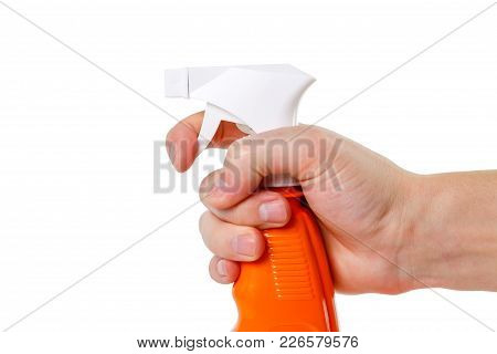 Spray Gun For Flowers. The Hand Holds. Close Up.