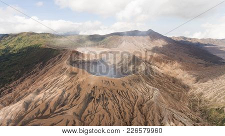 Crater With Active Volcano Smoke In East Jawa, Indonesia. Aerial View Of Volcano Crater Mount Gunung