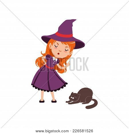Young Angry Red-haired Girl Witch Wearing Purple Dress And Hat. Smiling Kid Character In Costume Sco