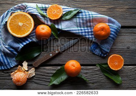 Tangerines With A Knife On A Wooden Background. Healthy Food. Fruit A