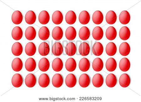 Set Of Red Eggs On A White Background, Laid In A Line.
