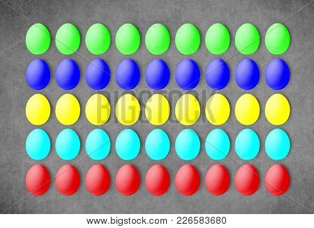Set Of Colorful Eggs On A Grey Background, Laid In A Line. Isolated