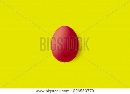 One Red Egg On A Yellow Background.  Minimalism Style