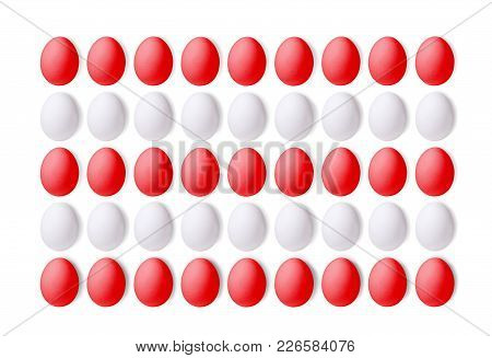Set Of Red And White Eggs On A White Background, Laid In A Line. Isolated