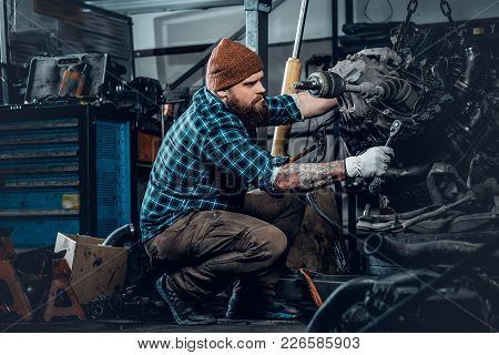 Brutal Bearded Mechanical Inspecting Engine Of A Car In A Garage.