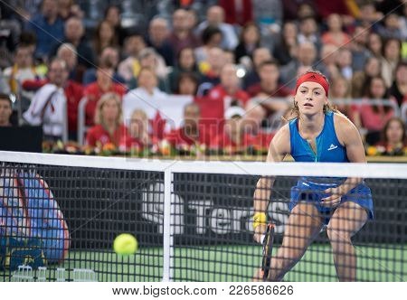 Tennis Players Playing A Double Match