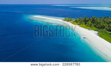 Aerial view of tropical iceland with sandy beach, Maldives. Exotic holiday in Indian ocean