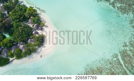 Aerial view of tropical resort with sandy beach, Maldives. Exotic holiday in Indian ocean