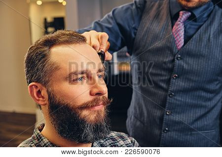 Portrait Of Handsome Casual Male In A Barbershop.