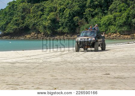 Kudat,sabah-feb 3,2018:happy Kids In Four Wheel Drive Truck On Sandy Tropical Beach In Kudat,sabah,m