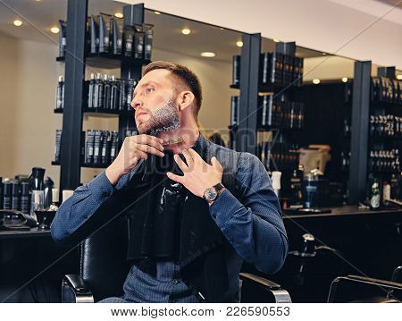 Stylish Male Shaving Himself In A Saloon.