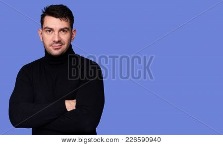 Confident Young Handsome Man In Turtleneck Sweater