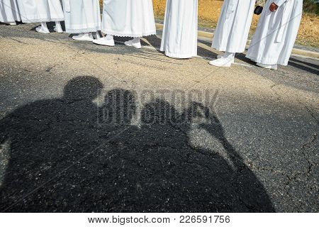 Tourist Shadows Taking Photos And Enjoying Easter Traditional Procession In Bercianos De Aliste Brot