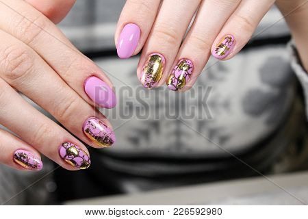 Women's Hands With A Stylish Manicure.