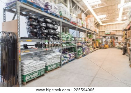 Blurred Variety Of Garden Soil And Garden Tools, Equipment