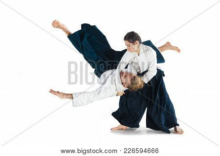 Man And Woman Fighting At Aikido Training In Martial Arts School. Healthy Lifestyle And Sports Conce