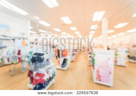 Blurred baby clothing, baby necessities and essentials store in America. Wide collection of baby, kids, and toddler clothing poster