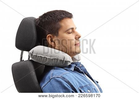 Young man with a neck pillow sleeping on a seat isolated on white background