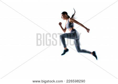 Dynamic Movement. Full Size Side Profile View Portrait Of Strong Sporty Muscular Beautiful Running F