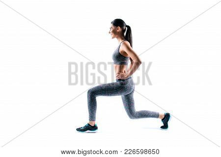 Profile Side View Photo Of Smiling Beautiful Charming Full Of Energy Sport Woman, She Is Doing Exerc