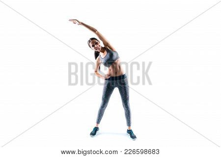 Happy Joyful Smiling Cheerful Happy Beautiful Attractive Sporty Woman Dressed In Sport Wear Is Incli