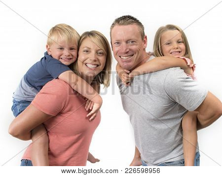 Young Happy And Beautiful American Family With Husband And Wife Carrying On Their Back Little Son An