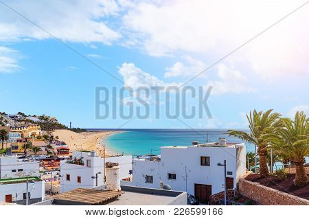 High Angle View Over Town Of Morro Jable And Tourist Resort On Fuerteventura Island With Beach And O