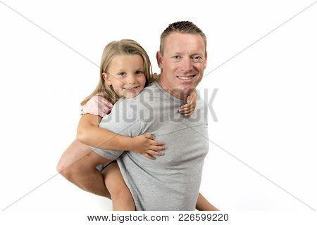 Young Attractive And Happy Man Carrying His Sweet Beautiful 7 Years Old Daughter On His Back In Fath