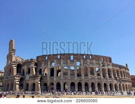 Rome, Italy - July 17, 2017: Tourists Near Colosseum In Rome, Italy. Rome Colosseum Is One Of The Ma