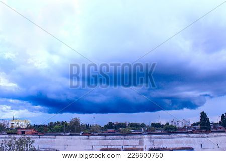 Storm-cloud Above The City. Landscape With Big And Awful Thundercloud
