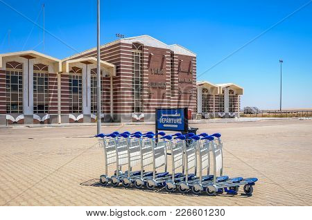Sinai Plateau, Egypt - August 8, 2011: Luggage Carts In Front Of The Building Of Taba International