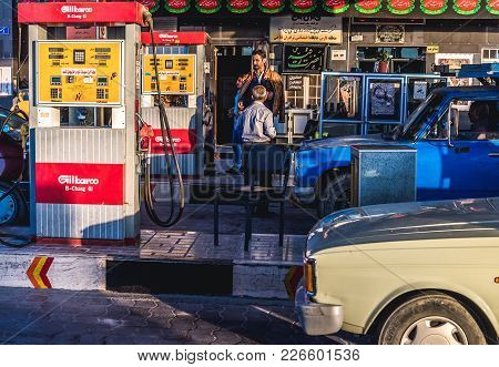 Marvdasht, Iran - October 22, 2017: Iranian Men On A Petrol Station In Marvdasht Town